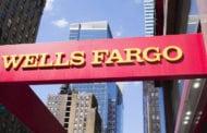 Fake accounts scandal still curbing Wells Fargo earnings