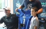 'Part of the family':  9-year-old Milton resident joins UWF football