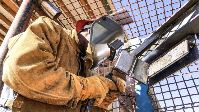 An inmate at the Walton County Jail is pictured welding a piece of steel during the flux core welding class.